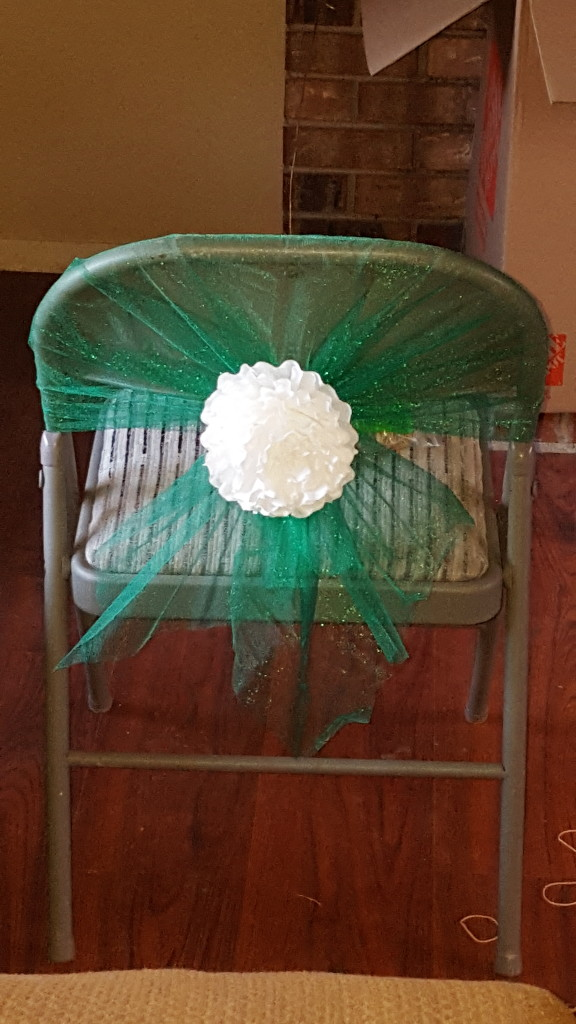 chair cover with white coffee filter flower